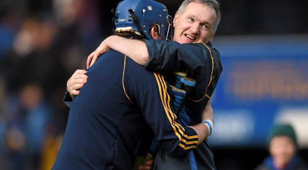 Tipperary manager Eamon O'Shea celebrates his side's victory over Dublin with goalkeeper Darragh Egan