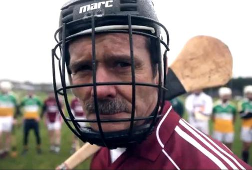 Astronaut Chris Hadfield takes up a hurley for Tourism Ireland