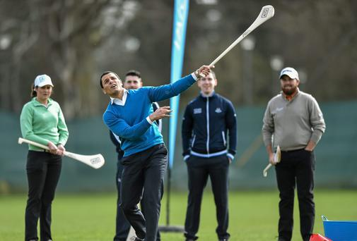 Former Munster star Doug Howlett trying his hand at hurling at yesterday's launch of AIG Ireland's partnership with the GUI and the IGLU