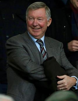 Former Manchester United manager Alex Ferguson takes his seat in the stand before their English Premier League soccer match against Manchester City at Old Trafford