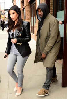 NEW YORK, NY - MARCH 25: Kim Kardashian and Kanye West are seen in Soho on March 25, 2014 in New York City. (Photo by Raymond Hall/GC Images)