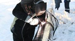 An engineer works on a PetroNeft pipeline in Siberia.