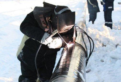 An engineer works on the Siberia- focused, oil- production company PetroNeft pipeline