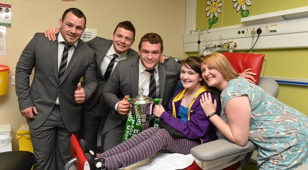 Members of the victorious Ireland Six Nations squad, from left, Cian Healy, Brian O'Driscoll and Jack McGrath with Lauren McCullough, from Dunleer, Co. Louth, and her mum Kerry and the RBS Six Nations Championship trophy on a visit to Temple Street Children's University Hospital, Dublin. Photo: Ray McManus / SPORTSFILE