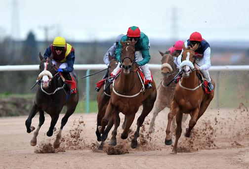 Cloverdale ridden by Joe Fanning (centre) wins The Download The Ladbrokes App Maiden Stakes at Southwell Racecourse