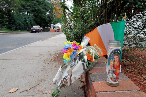 A memorial is seen near the site Irishman Ciaran Conneely was killed on Nahant Avenue in Boston.