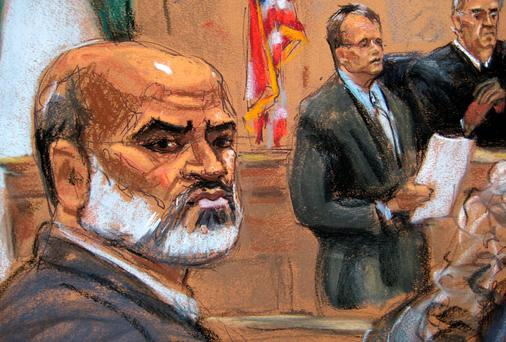 Osama bin Laden's son-in-law Suleiman Abu Ghaith (L) listens as courtroom deputy Andrew Mohan (2nd R) reads his verdict as Judge Lewis Kaplan (R) looks on during Ghaith's trial on terrorism charges in federal court in New York yesterday