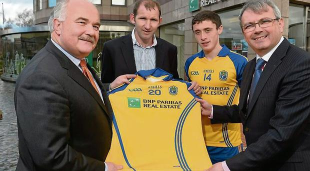 Patrick Curran, left, Managing Director of BNP Paribas Real Estate, with Roscommon Minor Football Team Manager Fergal O'Donnell, John Gannon, Roscommon Minor footballer and Thomas Carthy, Director of BNP Paribas Real Estate