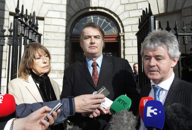 Ian Bailey (centre) and his partner Jules Thomas and solicitor Frank Buttimer