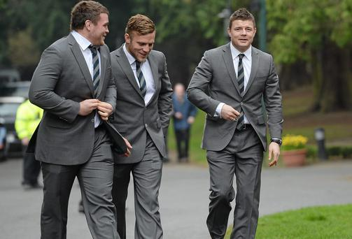Brian O'Driscoll, right, arrives at Farmleigh House with team-mates Jack McGrath, left, and Ian Madigan