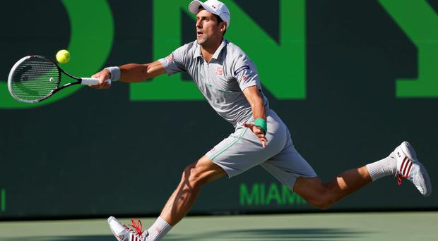 Novak Djokovic hits a forehand against Andy Murray