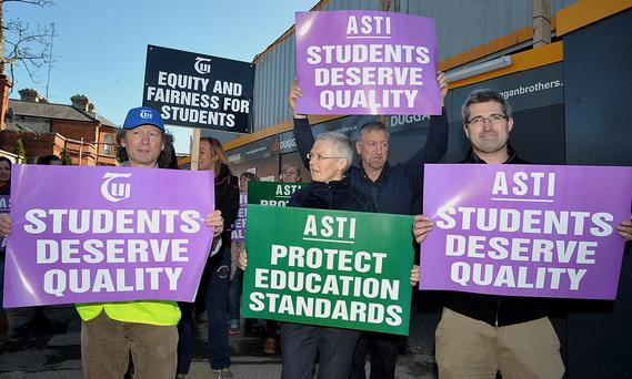 Teachers from the ASTI and the TUI protesting over the new junior cycle at Newpark Comprehensive School today.