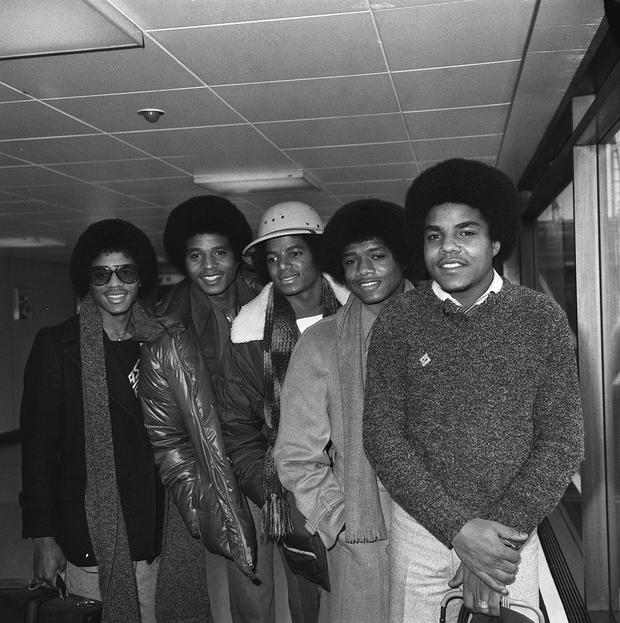 The Jackson Five arriving at Heathrow Airport, London in 1979, (left to right) Marlon, Jackie, Michael, Randy and Tito. PA Photo.