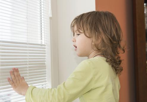 A child near a window blind (not victim - stock image)
