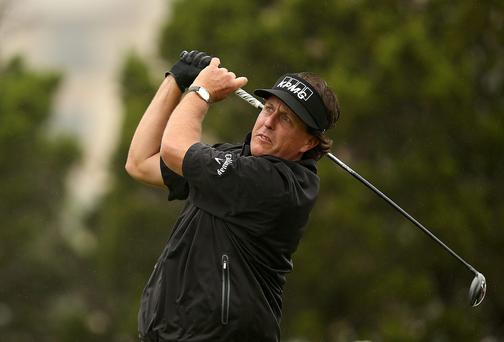 Phil Mickelson drives off at the 10th tee in the first round of the Valero Texas Open in San Antonio