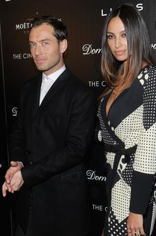 "Actor Jude Law and Madalina Diana Ghenea attends the Fox Searchlight Pictures' ""Dom Hemingway"" screening hosted by The Cinema Society And Links Of London on March 27, 2014 in New York City. (Photo by Jamie McCarthy/Getty Images)"
