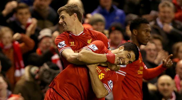 Liverpool's Steven Gerrard (left) celebrates with team-mate Luis Suarez after scoring a free-kick against Sunderland on Wednesday