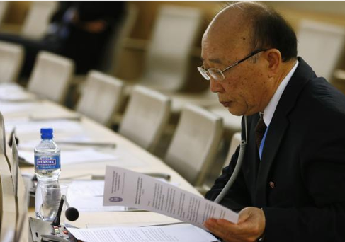 North Korea's ambassador to the United Nations So Se Pyong reads his notes before a session of the Human Rights Council on the report of the Commission of Inquiry on Human Rights in North Korea at the United Nations in Geneva on March 17, 2014.