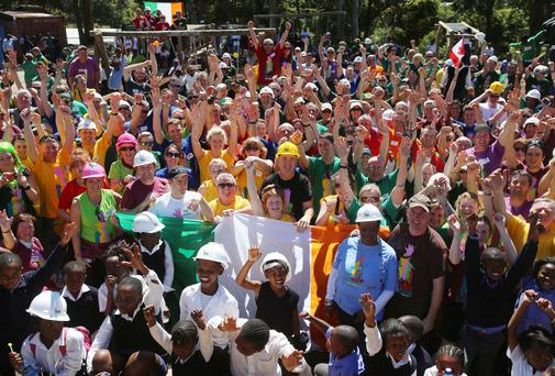 Irish volunteers and pupils celebrating at the opening of the refurbished Oranjekloof primary school Imizamo Yethu, Cape Town. Photo: Niall Carson/PA Wire