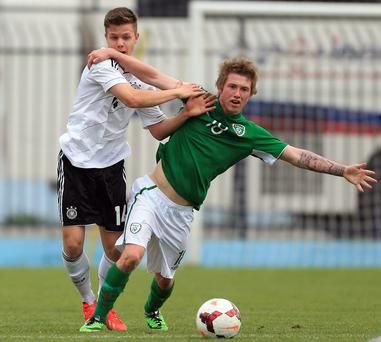 Ireland's Jesse Devers holds off Germany defender Patrick Kammerbauer during the UEFA Under17 Elite Round between Germany and Ireland at Stadion FC Obilic in Belgrade, Serbia