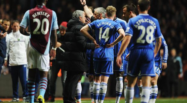 Jose Mourinho manager of Chelsea is sent off by referee Chris Foy during the game against Aston Villa