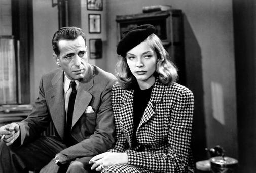 LACONIC: Humphrey Bogart, as Philip Marlowe, with Lauren Bacall in the film version of The Big Sleep