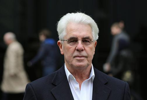 Publicist Max Clifford arrives at Southwark Crown Court in London yesterday