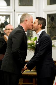 John Coffey (left) and Bernardo Marti during their wedding service at Mayfair Library, central London as the new law permitting same sex marriage in England and Wales comes into force. Photo: Westmister City Council/PA Wire
