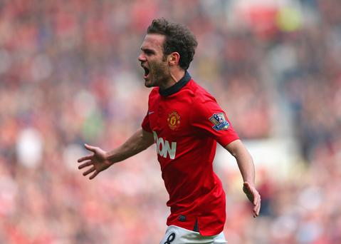 Juan Mata of Manchester United celebrates scoring his team's third goal