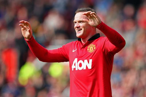 Wayne Rooney of Manchester United celebrates scoring his team's second goal from a penalty kick