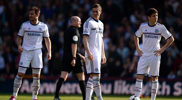 Chelsea's Fernando Torres (left) and teammate Oscar look dejected after Crystal Palace's goal