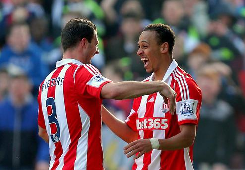 Stoke City's Peter Odemwingie (right) celebrates his goal with Stoke City's Erik Pieters