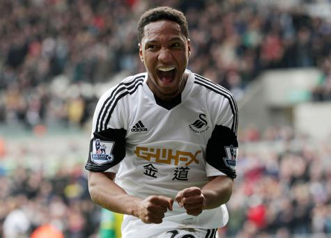 Swansea City's Jonathan de Guzman celebrates scoring his second goal against Norwich City