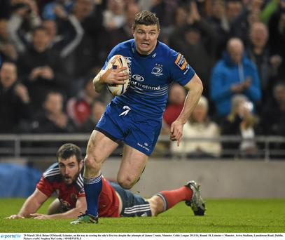 29 March 2014; Brian O'Driscoll, Leinster, on his way to scoring his side's first try despite the attempts of James Cronin, Munster. Celtic League 2013/14, Round 18, Leinster v Munster, Aviva Stadium, Lansdowne Road, Dublin. Picture credit: Stephen McCarthy / SPORTSFILE
