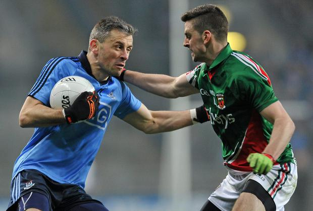 Alan Brogan, Dublin, in action against Brendan Harrison, Mayo