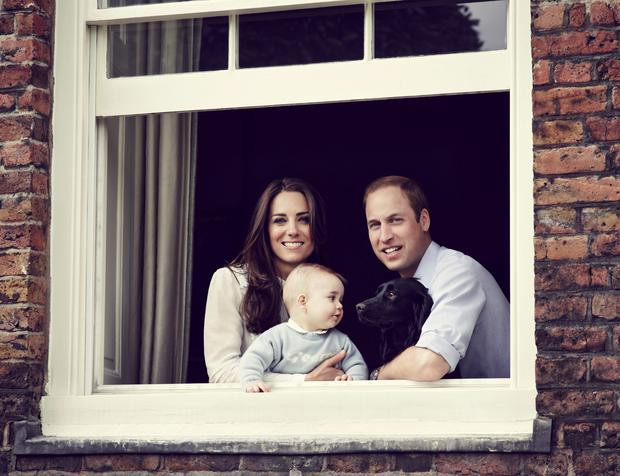 Duke and Duchess of Cambridge with their son, Prince George, taken in mid March 2014 in the Apartment 1A at Kensington Palace, central London ahead of their forthcoming tour to New Zealand and Australia next month.