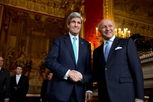 U.S. Secretary of State John Kerry shakes hands with French Foreign Minister Laurent Fabius (R) at the Quai d'Orsay in Paris March 30, 2014. REUTERS/Jacquelyn Martin/Pool