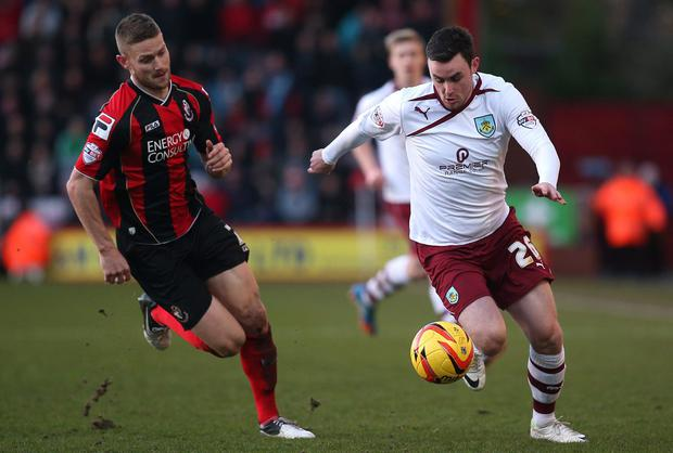 Keith Treacy of Burnley looks to get away from Bournemouth's Simon Francis
