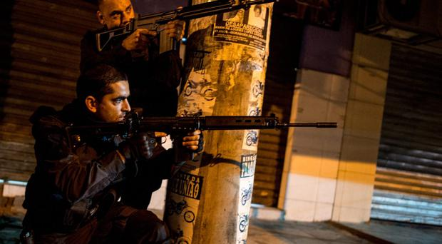 BOPE, the military police elite troop battalion, enter the unpacified Complexo da Mare, one of the largest 'favela' complexes in Rio