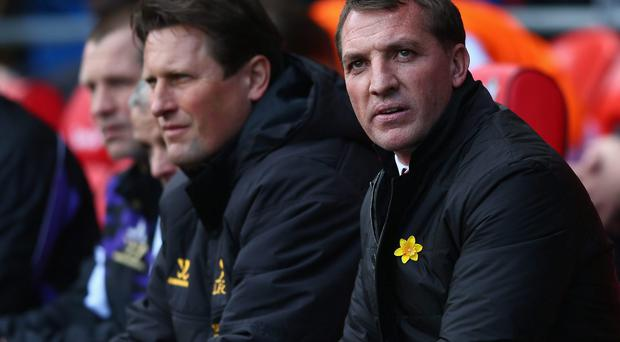Liverpool manager Brendan Rodgers looks on from the bench during Sunday's match against Tottenham Hotspur
