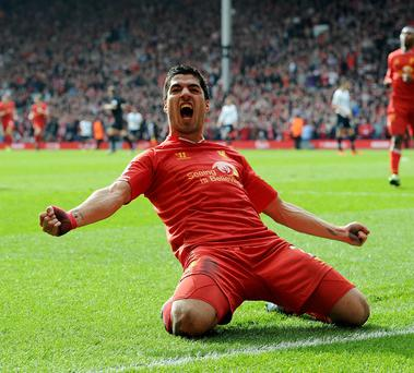 Luis Suarez celebrates after scoring Liverpool's second goal during their win over Tottenham at Anfield. Photo: Getty Images