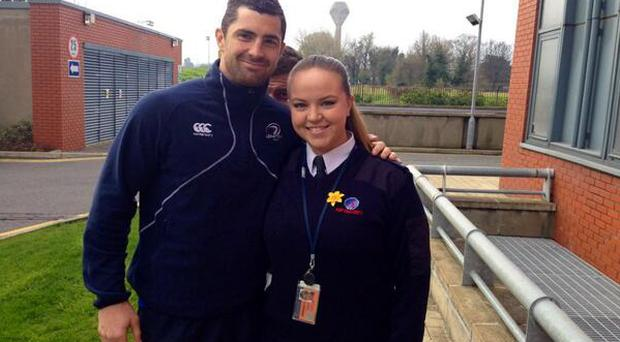 Rob Kearney and fan Ann Marie Stone with Brian O'Driscoll photobombing in the background