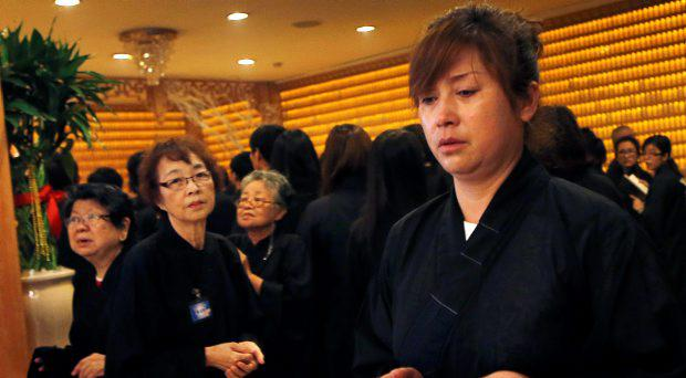 Chinese relatives of passengers from Flight MH370 offer prayers for their loved ones
