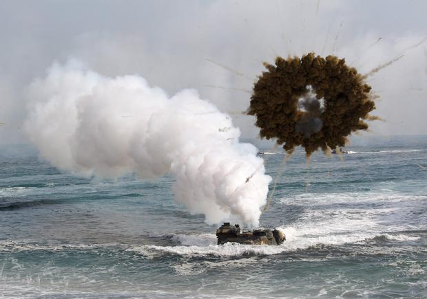 A South Korean marine LVT-7 landing craft sail to shores through a smoke screen during the U.S.-South Korea joint landing exercises called Ssangyong, part of the Foal Eagle military exercises, in Pohang, South Korea, Monday, March 31, 2014.