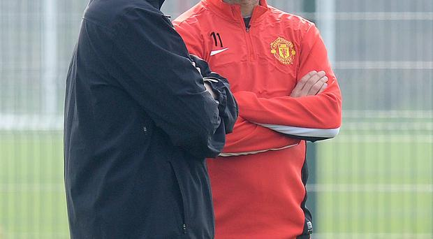 Former Manchester United manager David Moyes talks with Ryan Giggs