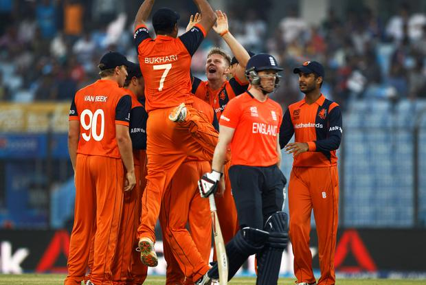 Netherlands's players celebrate the dismissal of England's Eoin Morgan, front, during their ICC Twenty20 Cricket World Cup match in Chittagong, Bangladesh