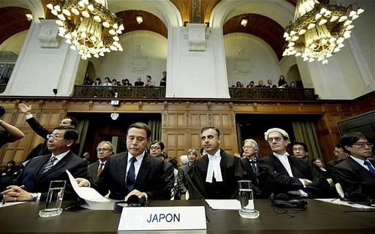 (Left-right) Koji Tsuruoka, Masaru Tsuji, Payam Akhavan, Alan Boyle and Yuji Iwasawa of the Japanese delegation prior to the announcement of a verdict in the case against Japanese whaling at the International Court of Justice in The Hague