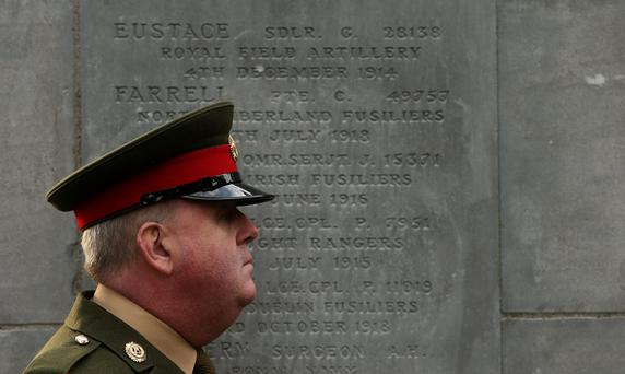 Sgt McCabe of the Military Police Company on duty at the laying of the foundation stone for a monumental Cross of Sacrifice at Glasnevin Cemetery, Dublin.
