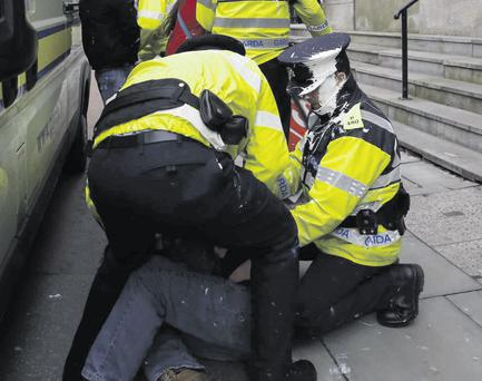 Gardai struggle with a protester outside the Justice Department in St Stephen's Green