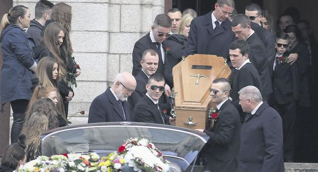 Farewell: Jason Saunders' coffin is carried from the church in Cabra